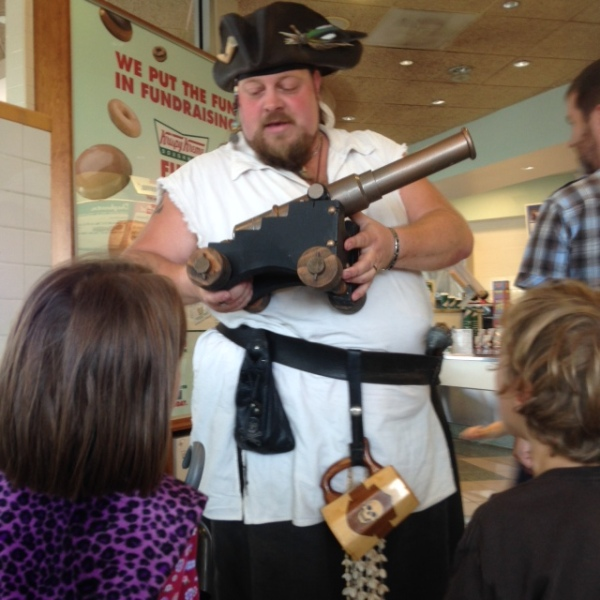 A pirate explains his ping pong cannon to my kids.